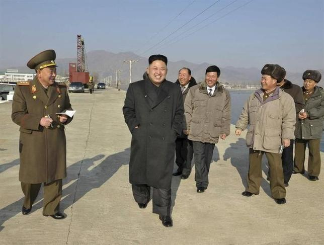North Korean leader Kim Jong Un (C) visits the Aquatic Products Refrigerating Facilities, which is newly built by KPA Unit 534, in this undated photo released by North Korea's Korean Central News Agency (KCNA) January 7, 2014. REUTERS/KCNA