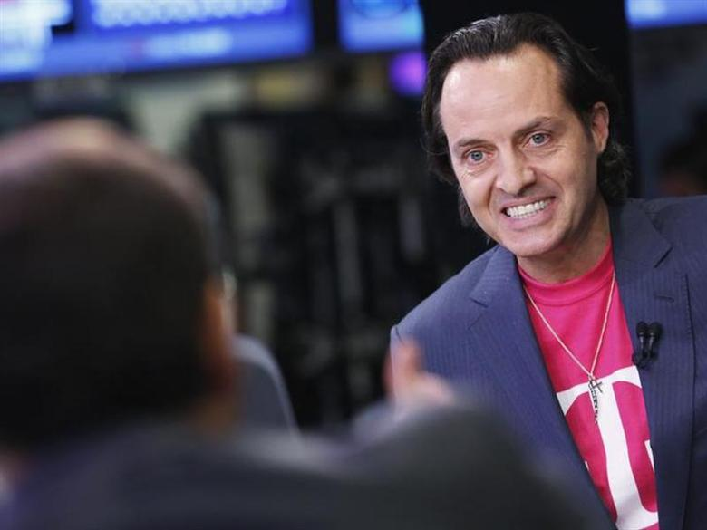 T-Mobile CEO John Legere gives an interview on the floor of the New York Stock Exchange, May 1, 2013. REUTERS/Brendan McDermid/Files