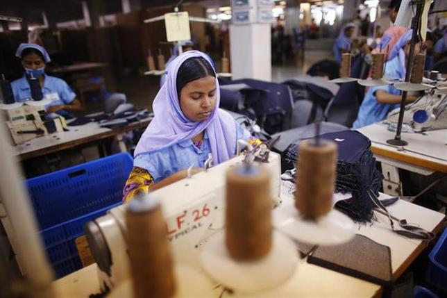 Workers sew clothes at a garment factory near the collapsed Rana Plaza building in Savar June 16, 2013. REUTERS/Andrew Biraj/Files