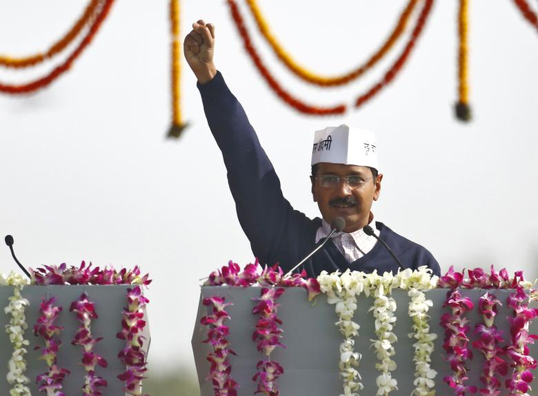 Arvind Kejriwal, leader of Aam Aadmi (Common Man) Party (AAP), shouts slogans after taking the oath as the new chief minister of Delhi during a swearing-in ceremony at Ramlila grounds in New Delhi December 28, 2013. REUTERS/Anindito Mukherjee