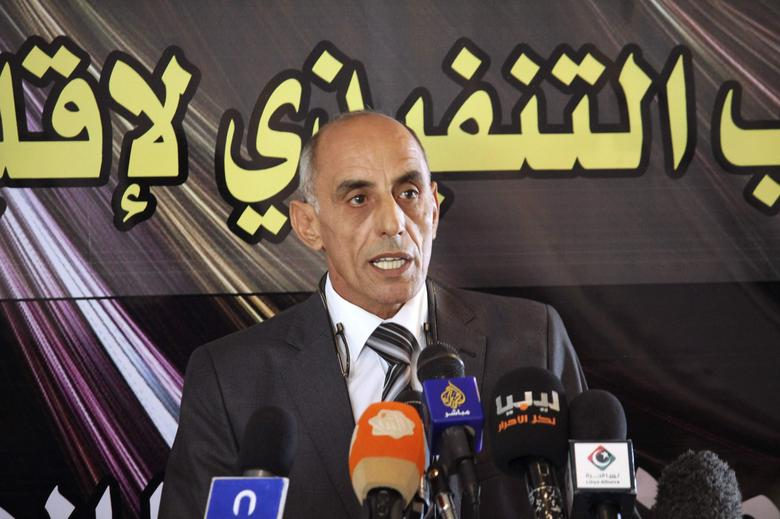 Abd-Rabbo al-Barassi, Chairman of the Executive Bureau of the Cyrenaica province,speaks during a news conference to announce the formation of a government for Cyrenaica, in Ajdabiya October 24, 2013. REUTERS/Stringer