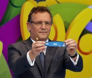 "FIFA Secretary General Jerome Valcke holds the slip showing ""Iran"" during the draw for the 2014 World Cup at the Costa do Sauipe resort in Sao Joao da Mata, Bahia state, December 6, 2013. REUTERS/Sergio Moraes"