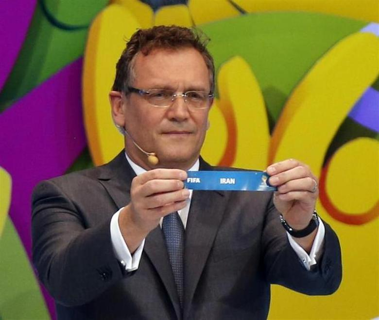 FIFA Secretary General Jerome Valcke holds the slip showing ''Iran'' during the draw for the 2014 World Cup at the Costa do Sauipe resort in Sao Joao da Mata, Bahia state, December 6, 2013. REUTERS/Sergio Moraes
