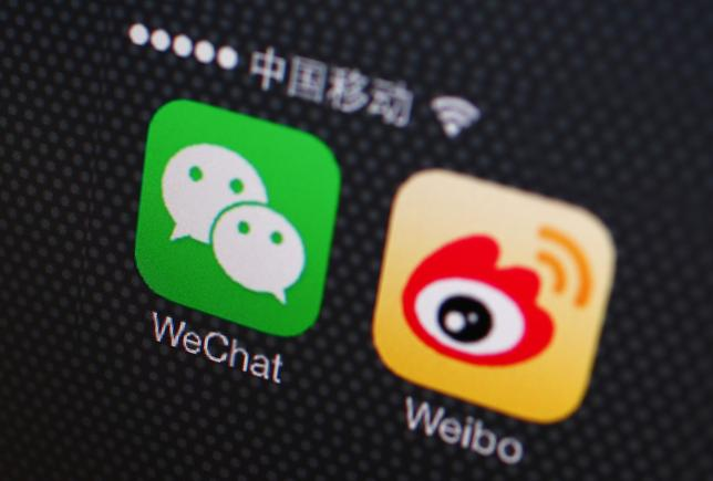 A picture illustration shows icons of WeChat and Weibo app in Beijing, December 5, 2013. REUTERS/Petar Kujundzic