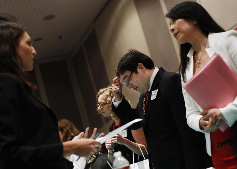 People meet with recruiters from jewelry and gem companies during the Gemological Institute of America (GIA)'s Jewelry Career Fair in New York July 30, 2012. REUTERS/Shannon Stapleton