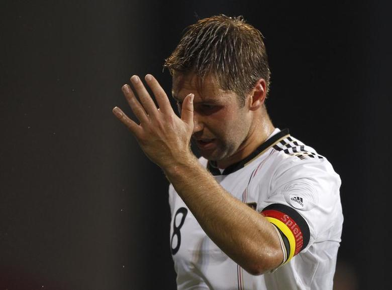 Germany's Thomas Hitzlsperger reacts during their international friendly soccer match against Denmark in Copenhagen August 11, 2010. REUTERS/Christian Charisius