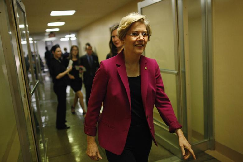 U.S. Senator Elizabeth Warren departs after the Senate passed a spending bill to avoid a government shutdown, sending the issue back to the House of Representatives, at the U.S. Capitol in Washington, September 27, 2013. REUTERS/Jonathan Ernst