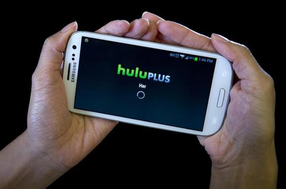 The HULU Plus app is played on a Samsung Galaxy phone in this photo-illustration in New York, December 23, 2013. REUTERS/Carlo Allegri/Files