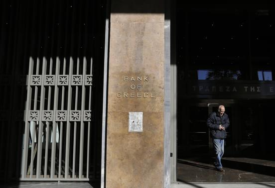 A man leaves the Bank of Greece headquarters in central Athens November 27, 2013. REUTERS-John Kolesidis
