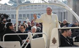 Fabian Baez, a priest from a church in downtown Buenos Aires, sits in the popemobile as Pope Francis arrives to lead the Wednesday general audience in Saint Peter's square at the Vatican January 8, 2014. REUTERS/Tony Gentile
