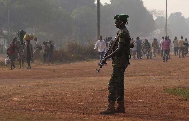 A Chadian soldier from the African Union peacekeeping mission to Central African Republic (MISCA) takes a strategic position along a combatant district in Bagui January 7, 2014. REUTERS/Emmanuel Braun