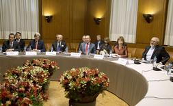 (L-R) China's Foreign Minister Wang Yi, U.S. Secretary of State John Kerry, France's Foreign Minister Laurent Fabius, Russia's Foreign Minister Sergei Lavrov, EU Foreign Policy Chief Catherine Ashton and Iran's Foreign Minister Mohammad Javad Zarif attend the Iran nuclear talks at the Palais des Nations in Geneva November 24, 2013. REUTERS/Carolyn Kaster/Pool