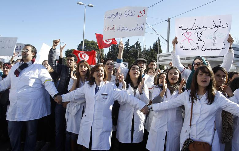 Doctors and resident doctors shout slogans during a demonstration against the government's new draft law that will require healthcare professionals to work at public hospitals in rural areas for an added three years before they graduate, outside the Constituent Assembly headquarters in Tunisia January 7, 2014. REUTERS/Zoubeir Souissi