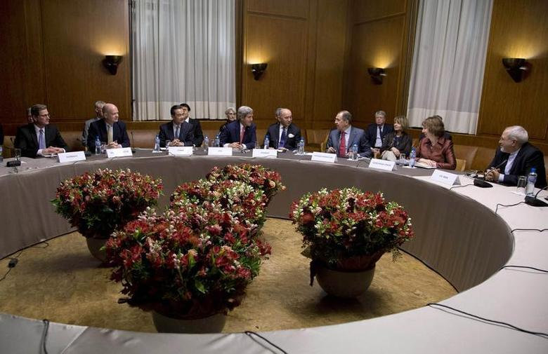 (L-R) Germany's Foreign Minister Guido Westerwelle, British Foreign Secretary William Hague, Chinese Foreign Minister Wang Yi, U.S. Secretary of State John Kerry, French Foreign Minister Laurent Fabius, Russia's Foreign Minister Sergei Lavrov, EU foreign policy chief Catherine Ashton and Iranian Foreign Minister Mohammad Javad Zarif gather at the United Nations Palais in Geneva November 24, 2013 File photo. REUTERS/Carolyn Kaster/Pool