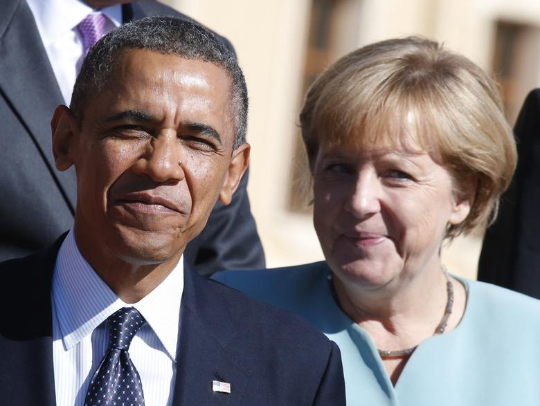 U.S. President Barack Obama and German Chancellor Angela Merkel arrive for the family picture event during the G20 summit in St.Petersburg September 6, 2013. REUTERS/Grigory Dukor