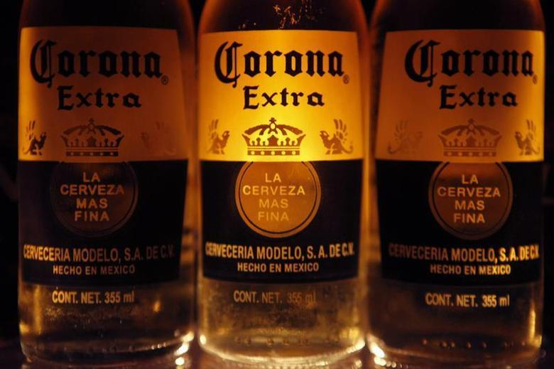 Bottles of Corona beer, the flagship brand of Group Modelo, are seen in Mexico City February 14, 2013. REUTERS/Edgard Garrido