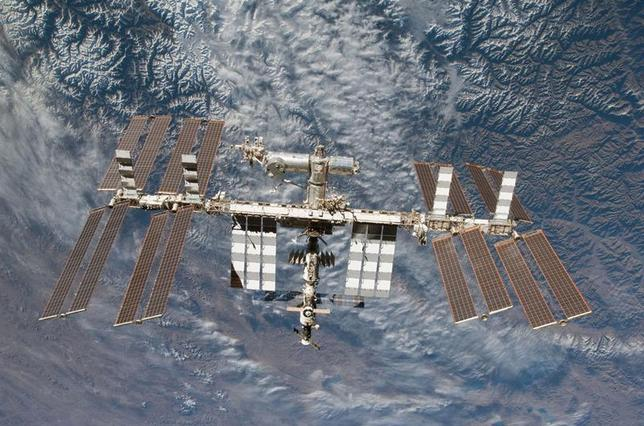 Backdropped by Earth, the International Space Station is seen in this image photographed by an STS-130 crew member on space shuttle Endeavour after the station and shuttle began their post-undocking relative separation, in this undated NASA handout photo. REUTERS/NASA/Handout