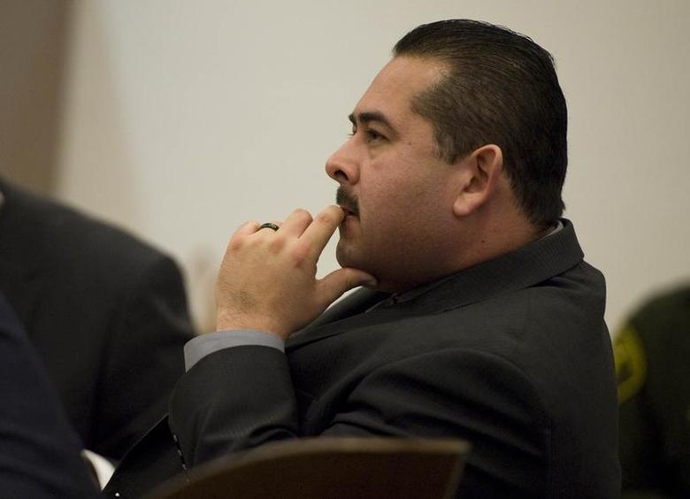 Former Fullerton police officer Manuel Ramos sits during his trial in Santa Ana, California January 7, 2014. REUTERS/Pool