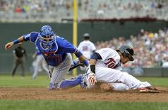 Toronto Blue Jays catcher J.P. Arencibia (L) tags out Minnesota Twins Pedro Florimon at home in the sixth inning of their MLB American League Baseball game in Minneapolis September 8, 2013. REUTERS/Craig Lassig