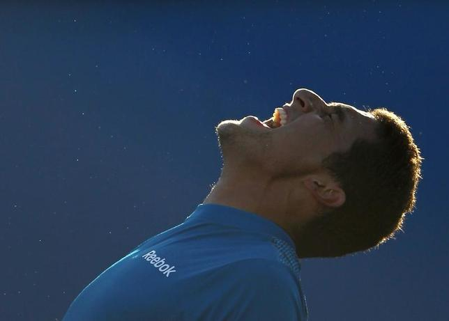 Spain's Nicolas Almagro celebrates after winning against Alejandro Falla of Colombia at the Australian Open tennis tournament in Melbourne January 23, 2010. REUTERS/Vivek Prakash