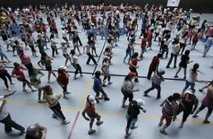 People participate in an aerobics class at the gymnasium of a sports center in Cartago, east of San Jose July 10, 2012. REUTERS/Juan Carlos Ulate