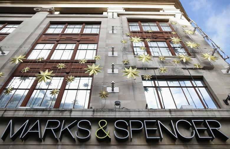 Christmas decorations adorn the exterior of retailer Marks and Spencer's flagship store in London's West End, November 5, 2013. REUTERS/Andrew Winning