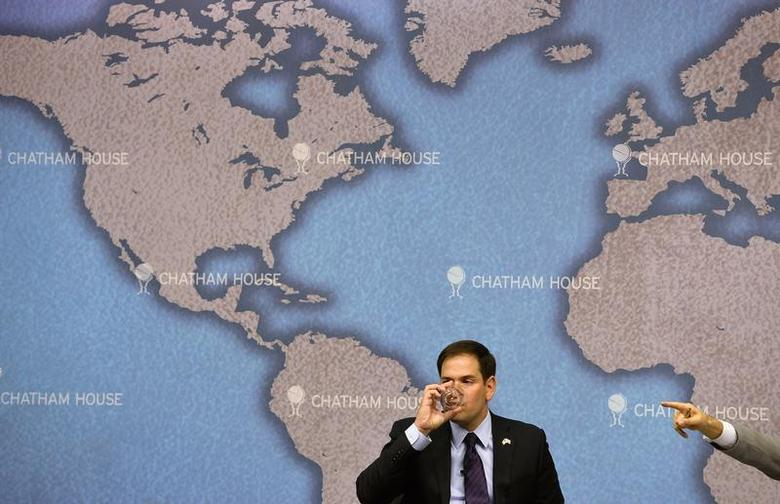 U.S. Republican Senator Marco Rubio drinks as he prepares to answer questions after delivering his keynote speech entitled 'American Leadership and the future of the Transatlantic Alliance' at Chatham House in London December 3, 2013. REUTERS/Toby Melville