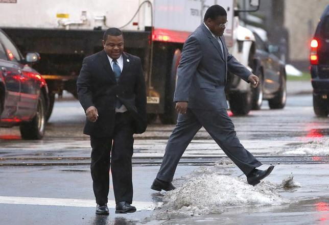 Trenton New Jersey Mayor Tony Mack (left) and his brother Ralphiel Mack (right) arrive at United States Court in Trenton, New Jersey, January 6, 2014. REUTERS/Mike Segar