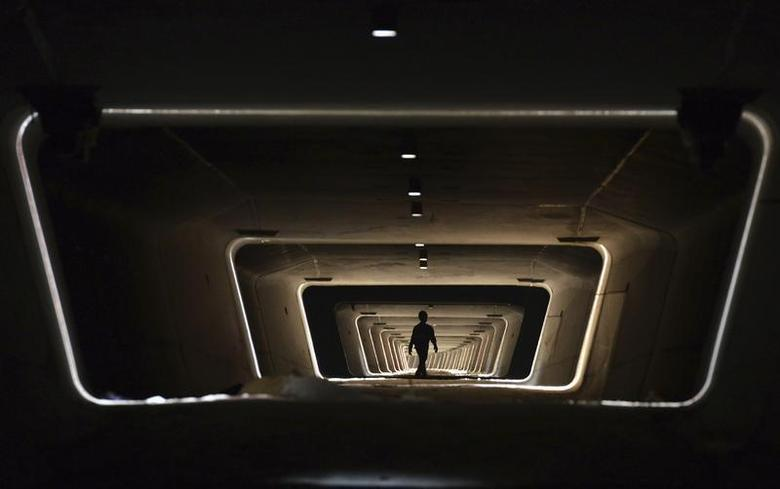 A worker walks in the foundation of a new railway line in Yiwu, Zhejiang province, May 21, 2013. REUTERS/China Daily