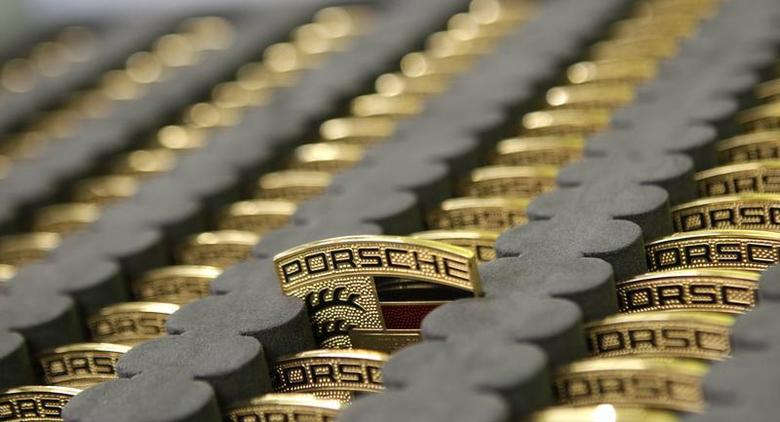 Car emblems for the new Porsche 918-Spyder are placed in a box at the production line of the German car manufacturer's plant in Stuttgart-Zuffenhausen July 2, 2013. REUTERS/Michaela Rehle