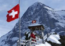 Chinese ski instructor Xu Zhongxing poses on the Kleine Scheidegg in front of the Eiger north face in the ski resort of the Jungfrau region January 8, 2014. REUTERS/Ruben Sprich