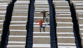 People jump from concrete elements of the Holocaust memorial in Berlin January 25, 2013. REUTERS/Fabrizio Bensch