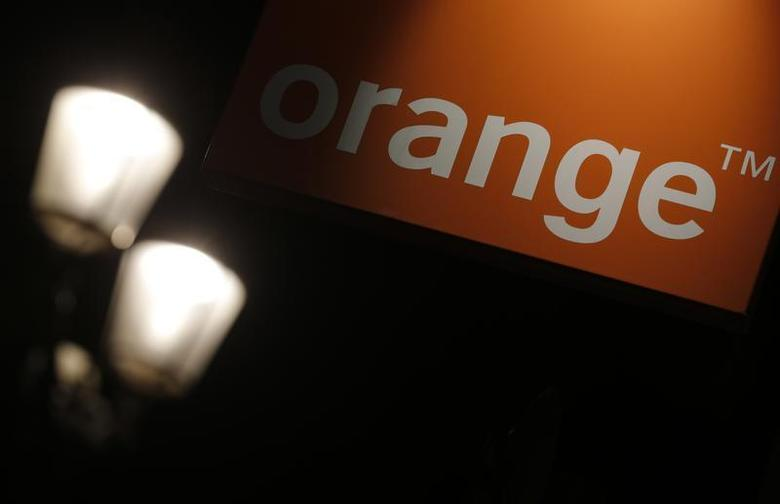 The logo of the Orange telecommunication and internet provider is seen on the facade of a store in Paris July 24, 2013. REUTERS/Christian Hartmann