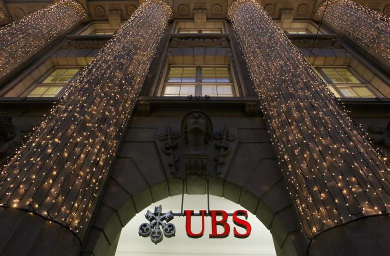 Christmas lights are illuminated at an office building of Swiss bank UBS in Zurich in this file photo taken December 4, 2012. REUTERS/Arnd Wiegmann/Files