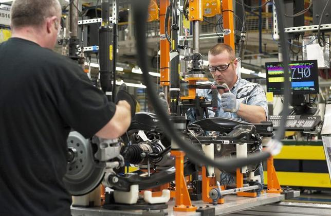 A production line worker installs a brake and rotor unit are on the rear axle assembly of a 2014 Jeep Cherokee at the upgraded North section of the Chrysler Toledo Assembly Complex which will be used to produce the new vehicle, as seen during a media tour, in Toledo, Ohio July 18, 2013. REUTERS/James Fassinger