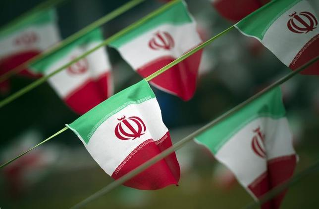 Iran's national flags are seen on a square in Tehran February 10, 2012. REUTERS/Morteza Nikoubazl