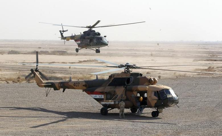 An Iraqi helicopter prepares to land during training at Basmaya military base in Baghdad November 25, 2011. REUTERS/Mohammed Ameen
