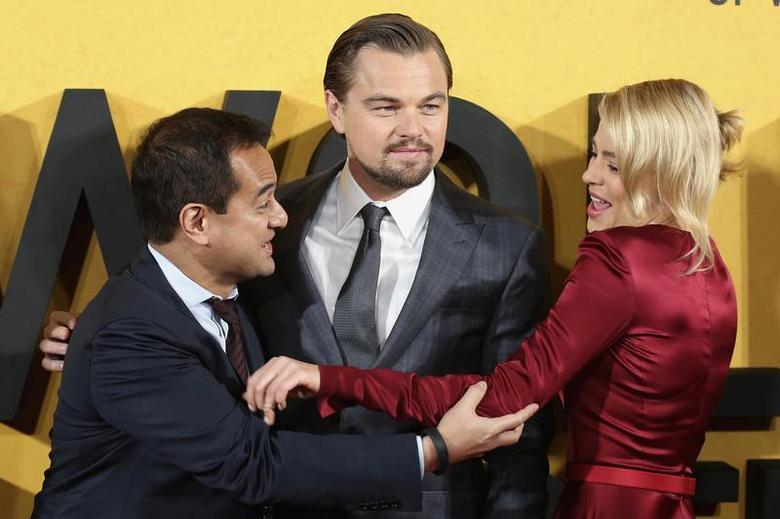 Producer Riza Aziz (L), and cast members Leonardo DiCaprio and Margot Robbie arrive for the U.K. Premiere of ''The Wolf of Wall Street'' at Leicester Square, London January 9, 2014. REUTERS/Paul Hackett