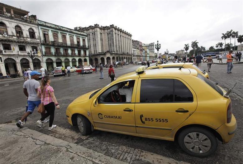 A taxi driver awaits customers in Havana January 8, 2014. REUTERS/Enrique de la Osa