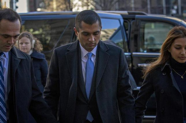 Former SAC Capital portfolio manager Mathew Martoma (C) arrives at the Manhattan Federal Courthouse with his lawyer in New York, January 7, 2014. REUTERS/Brendan McDermid