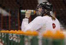 Canada's Hayley Wickenheiser drinks during a team practice session at the IIHF Ice Hockey Women's World Championship in Ottawa April 7, 2013. REUTERS/Chris Wattie