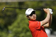 Sang-Moon Bae of South Korea hits off the 15th tee during the first round at the Sony Open golf tournament at Waialae Country Club in Honolulu, Hawaii, January 9, 2014. REUTERS/Hugh Gentry