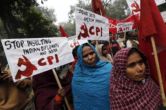 Supporters of Communist Party of India (CPI) hold placards during a protest near the American Center in New Delhi December 21, 2013. REUTERS/Adnan Abidi/Files
