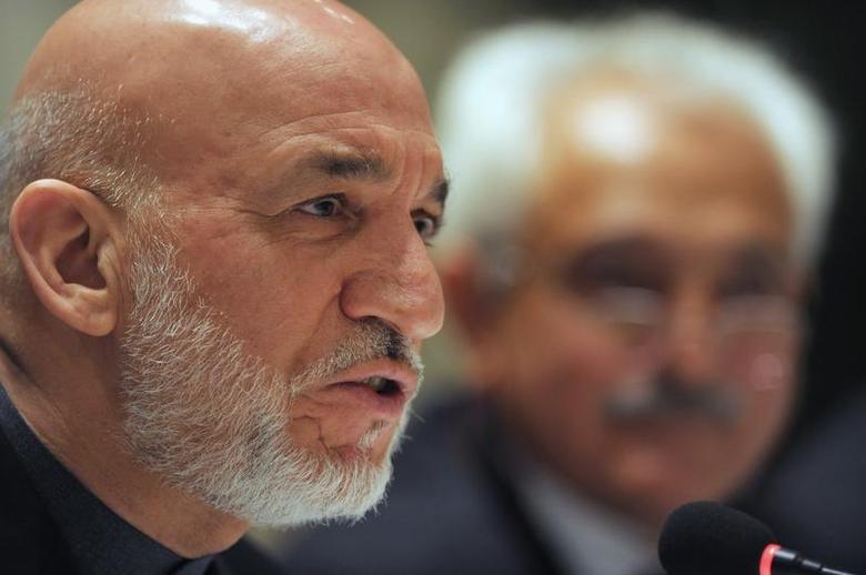 Afghanistan's President Hamid Karzai addresses media representatives during a press interaction in New Delhi December 14, 2013. REUTERS/Findlay Kember/Pool