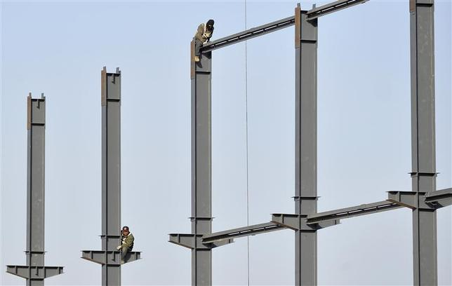 Labourers install steel frames to a new food factory in Taiyuan, Shanxi province January 8, 2014. REUTERS/Jon Woo