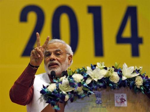 Hindu nationalist Narendra Modi, prime ministerial candidate for the main opposition Bharatiya Janata Party (BJP) and Gujarat's chief minister, gestures while addressing the National Education Summit in Gandhinagar, in Gujarat, January 10, 2014. REUTERS/Amit Dave