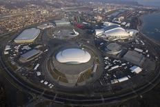 An aerial view from a helicopter shows the Olympic Park under construction in the Adler district of the Black Sea resort city of Sochi, December 23, 2013. REUTERS/Maxim Shemetov