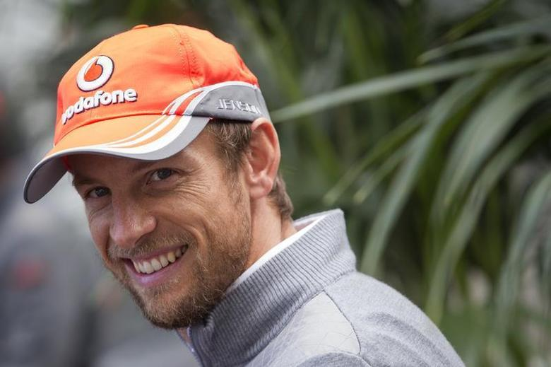 McLaren Formula One driver Jenson Button of Britain smiles while giving an interview at the Circuit of The Americas in Austin, Texas November 14, 2013. REUTERS0/Adrees Latif