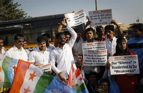 Members of the National Students Union of India (NSUI), the student wing of ruling Congress party, shout slogans during a protest in front of the U.S consulate in Mumbai December 20, 2013. REUTERS/Danish Siddiqui