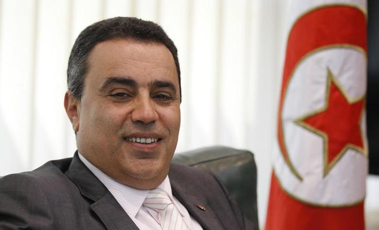 Tunisia's Industry Minister Mehdi smiles in his office in Tunis in this June 25, 2013 file photo. REUTERS/Anis Mili/Files
